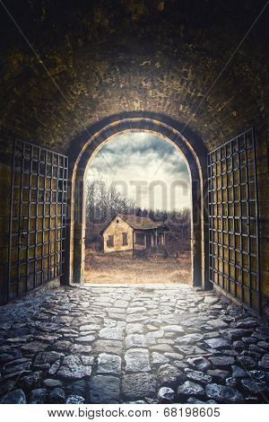 Gate Opening To Road Leading To An Old Abandoned House