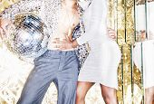 image of pimp  - 70s disco style couple posing with mirror ball - JPG