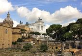 stock photo of emanuele  - view of the monument to Vittorio Emanuele from the ruins of famous ancient Roman Forum - JPG