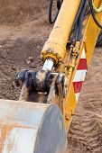 stock photo of backhoe  - Excavator loader with backhoe standing at construction site - JPG