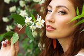pic of jasmine  - young beautiful sexy girl with a seductive biggest lips with long red hair sitting in the Park near the tree Jasmine - JPG