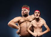 stock photo of body fat  - Funny body builders - JPG