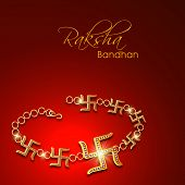 stock photo of swastik  - Beautiful rakhi made by golden Swastik on red background - JPG