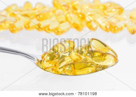 Omega 3 Fish Oil Capsules On Spoon