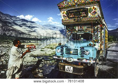 Man Cleans His Overland Truck With Water From A Creek