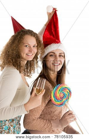 Two girls celebrate christmas or new year