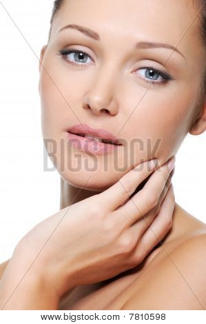 Portrait Of Caucasian Beautiful Woman Stroking Her Face