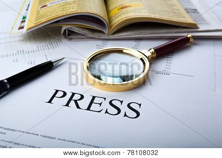 Magnifier And Sign The Press