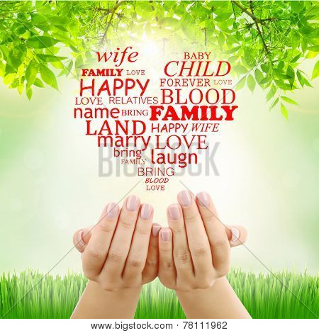 Family concept, family word cloud in hands on nature background