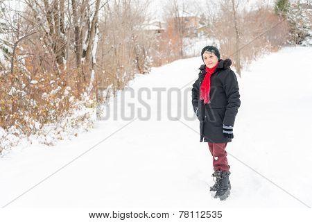 Hispanic Senior Woman Enjoying Her First Snow