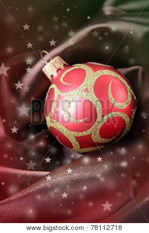 Beautiful Christmas ball on brown satin cloth