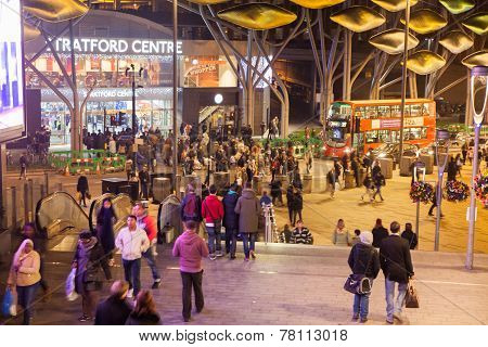 London, Stratford village square with shopping centre entrance and bus stop