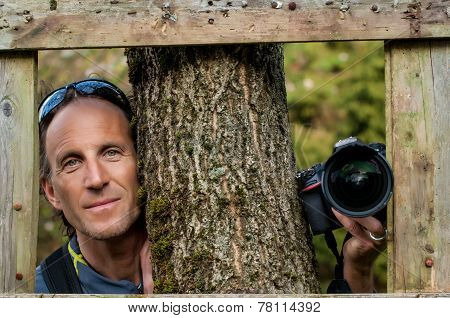 Photographer Man Near The Tree