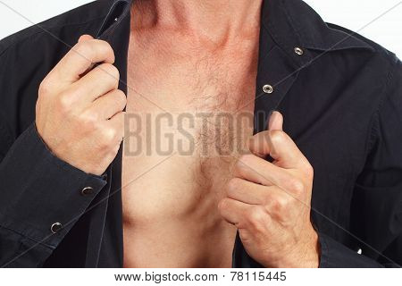 Young man undresses his black shirt closeup