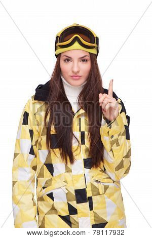 Young woman in snowboard clothes pointing finger up