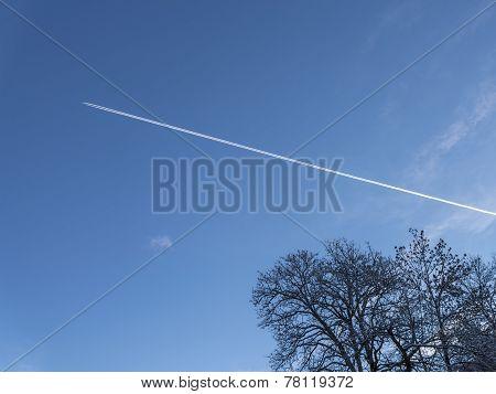 Contrail In Winter Sky