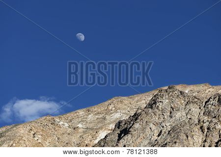 Big White Moon Over Rocks