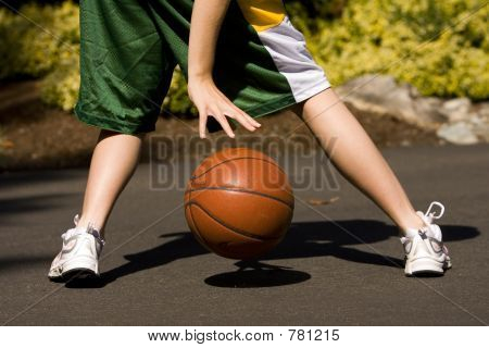 Female dribbling a basketball