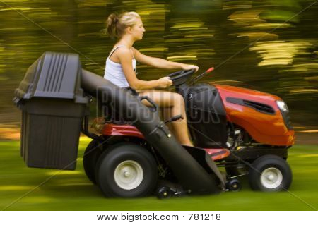 Teenager mowing the lawn