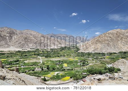 Green Oasis Village Among Mountains View