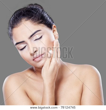 Beautiful Woman Touching Her Skin Face