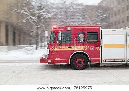 Toronto Fire Truck Moving Down A Road