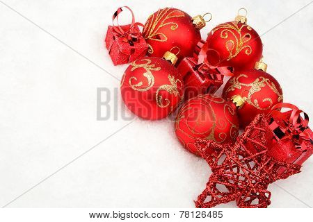 Group Of Red Christmas Baubles,gifts,star On Snow At Corner