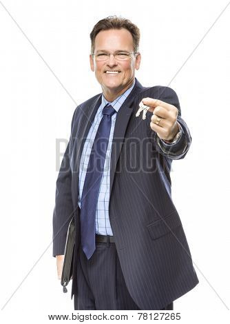 Handsome Real Estate Agent Holding Out Keys to New Home Isolated on a White Background.