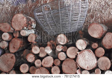 Logs And Wicker Basket