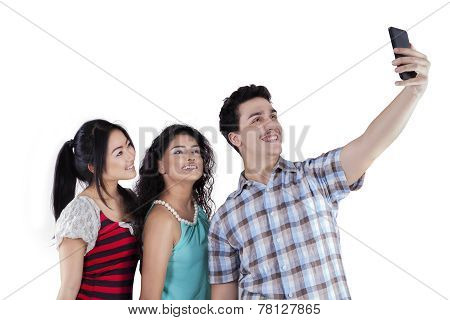 Multiethnic Teenagers Taking Self Photo