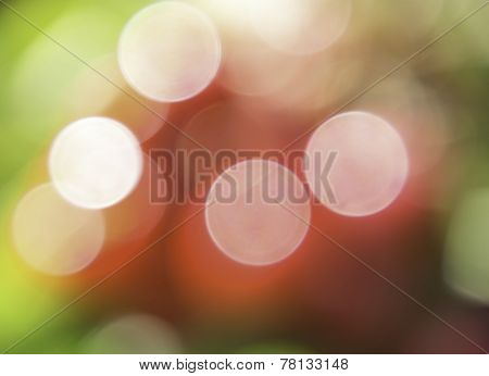 Color Bokeh against a green background for use at graphic design