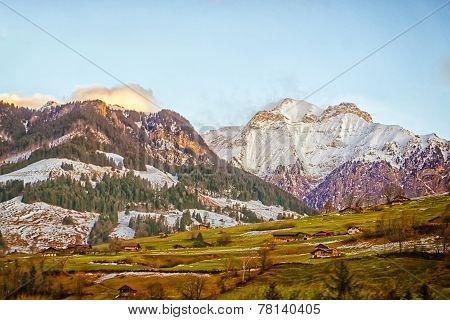 Swiss Village On The Mountain Slope In Highland Near Peak