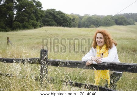 Woman Leaning On Fence