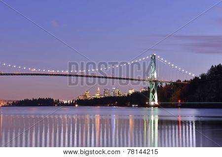 Lions Gate Bridge And Downtown Vancouver At Sunset