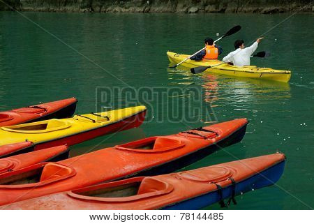 Tourist are kayak paddle in Halong Bay,Vietnam.