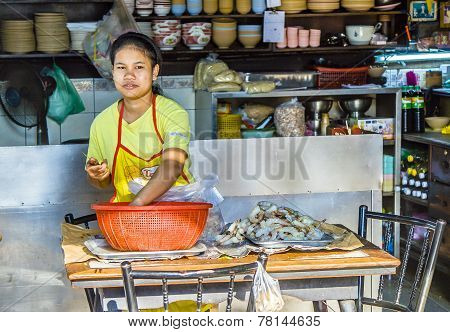 Woman Prepares Shrimps For Cooking