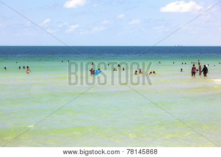 People Enyoy The Beach And Swimming In South Beach