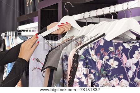 Female Clothes On Hangers In Fashion Boutique