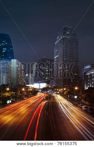 Vehicle Lighting On Urban Road And Building Against Night Scene Sky Of Bangkok Thailand