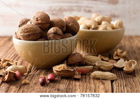 Bowl With Walnuts In Front And With Peanuts Back