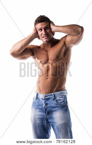 Irritated, Frustrated, Stressed Muscle Guy Covering His Ears