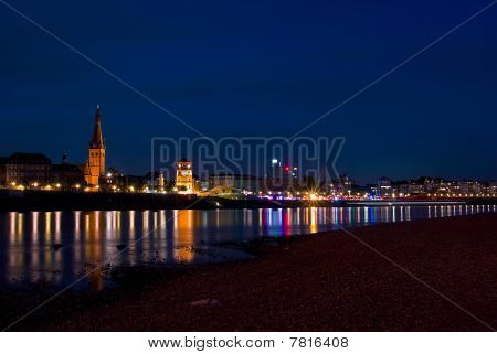 Historical City Of Duesseldorf And Rhine At Night