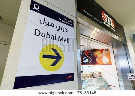 DUBAI - OCTOBER 15: The Dubai Mall pointer on October 15, 2014 in Dubai, UAE. The Dubai Mall located in Dubai, it is part of the 20-billion-dollar Downtown Dubai complex, and includes 1,200 shops.