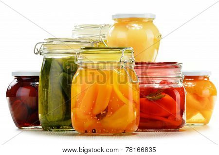 Jars With Pickled Vegetables And Fruity Compotes On White