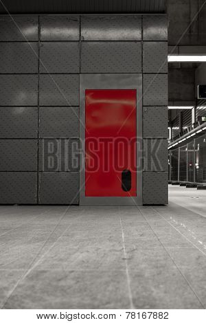 Gray steel wall with the red door