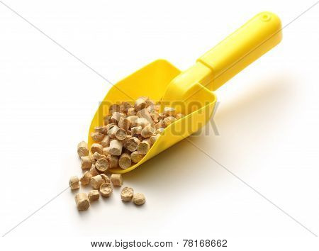 Wooden Pellets On Yellow Shovel
