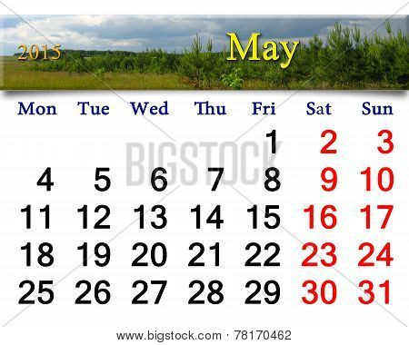 Calendar For May Of 2015 With Thunder Storm Clouds And Pines