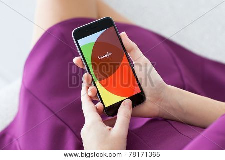 Woman Holding Iphone 6 With Google Plus On The Screen