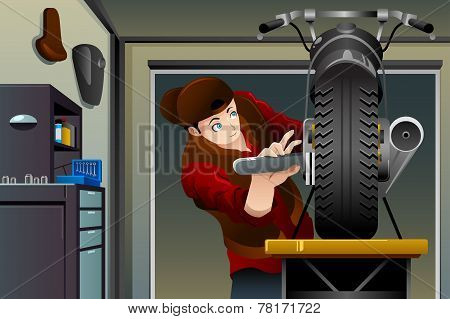 Man Fixing A Motorcycle