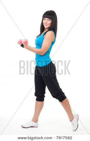 Young Positive Woman Holing Dumbbells